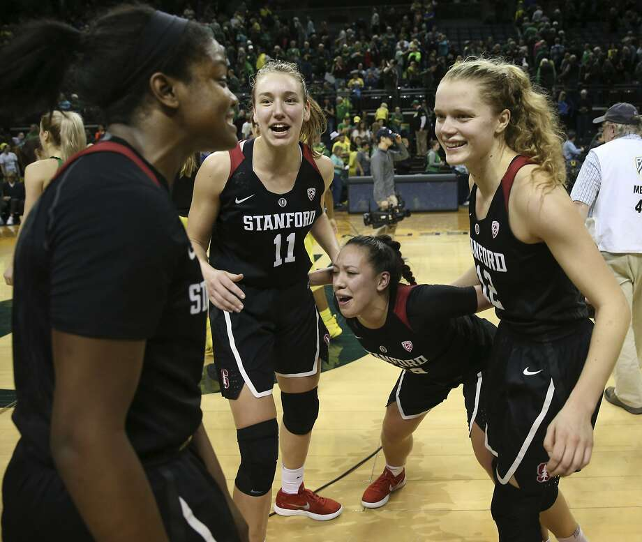 Stanford's Nadia Fingall, left, Alanna Smith, and Marta Sniezek celebrate with Brittany McPhee, right, after she led the team in scoring to defeat Oregon in an NCAA women's basketball game in Eugene, Ore., Sunday, Feb 4, 2018. (Chris Pietsch/The Register-Guard) Photo: Chris Pietsch, Associated Press