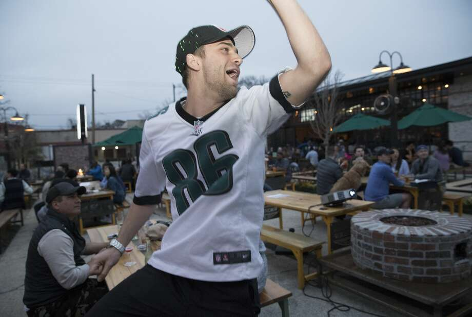Philadelphia Eagles fan Nick Copeland reacts to the Eagles scoring a touch down during the first quarter of the Super Bowl LII at Heights Bier Garten on Sunday, Feb. 4, 2018, in Houston. Copeland is a born and raised Texan but the Eagles has been his team since he started watching football. ( Yi-Chin Lee / Houston Chronicle ) Photo: Yi-Chin Lee/Houston Chronicle