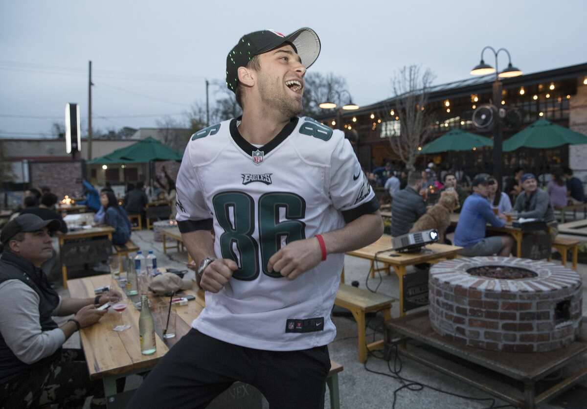 Philadelphia Eagles fan Nick Copeland reacts to the Eagles scoring a touch down during the first quarter of the Super Bowl LII at Heights Bier Garten on Sunday, Feb. 4, 2018, in Houston. Copeland is a born and raised Texan but the Eagles has been his team since he started watching football. ( Yi-Chin Lee / Houston Chronicle )