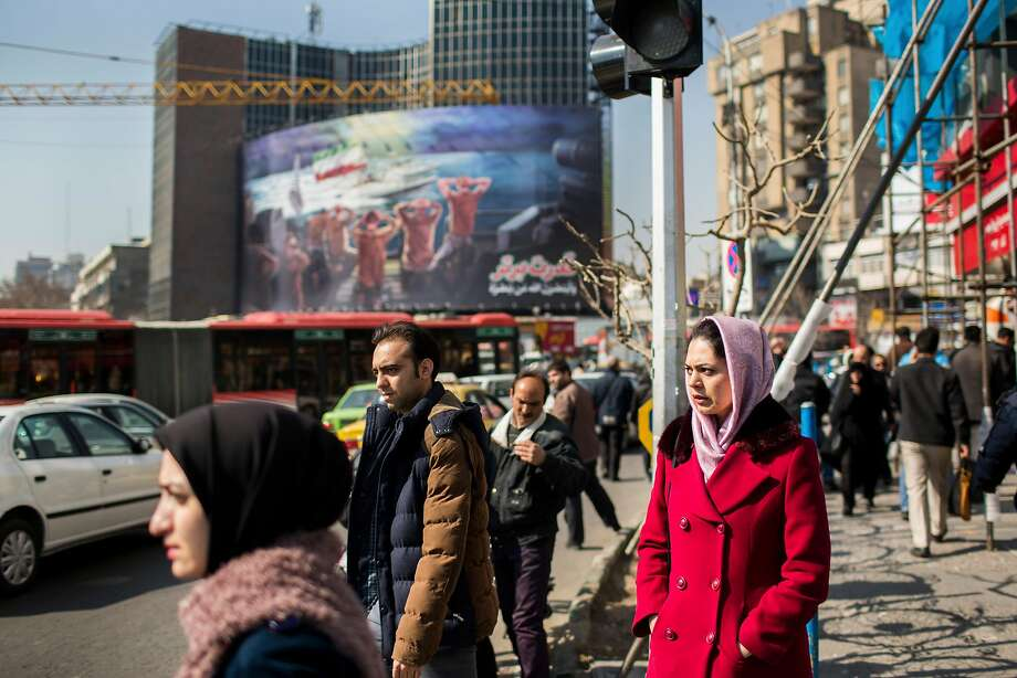Women wear hijabs in Tehran. A report finds nearly half of Iranians want an end to the law. Photo: ARASH KHAMOOSHI, NYT