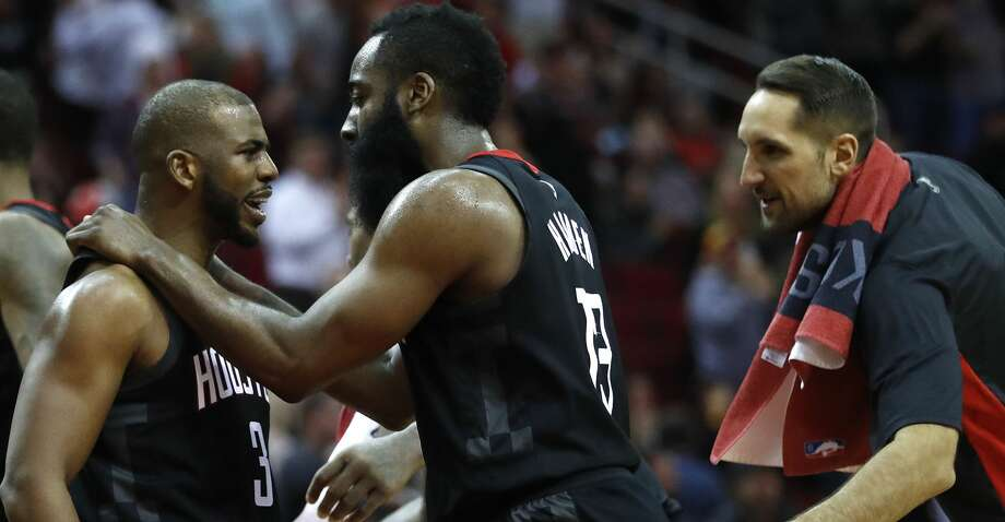 Houston Rockets guards James Harden (13) and Chris Paul (3) celebrate after one of Harden's three-pointers during the second half of an NBA game at Toyota Center, Monday, Dec. 11, 2017, in Houston. Rockets won 130-123.   ( Karen Warren / Houston Chronicle ) Photo: Karen Warren/Houston Chronicle