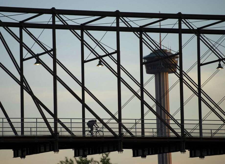 A cyclist traverses the Hays Street Bridge, Friday, May 3, 2013, in San Antonio. Photo: Darren Abate /For The Express-News / San Antonio Express-News