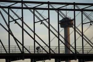 A cyclist traverses the Hays Street Bridge, Friday, May 3, 2013, in San Antonio.