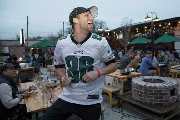 Philadelphia Eagles fan Nick Copeland rejoices at Heights Bier Garten as the Eagles score a touch down during the first quarter of Super Bowl LII on Sunday in Houston.