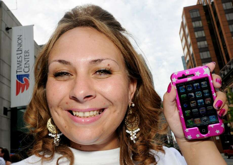 Tanya Manzer, 29, of Schenectady, with her iPhone (Luanne M. Ferris / Times Union) Photo: LMF