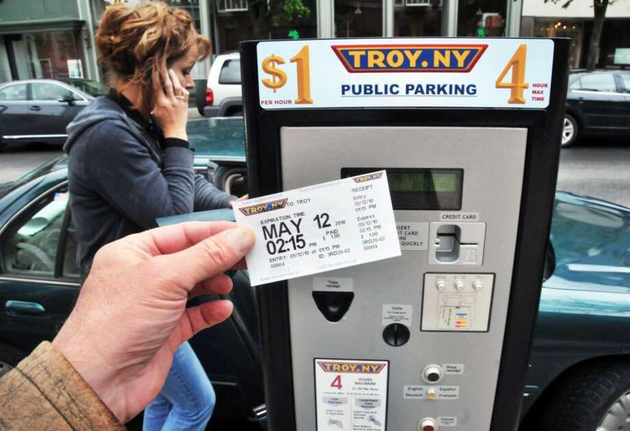 A receipt from one of the newly installed parking meters on Broadway in Troy.   (John Carl D'Annibale / Times Union) Photo: John Carl D'Annibale / 00008713A
