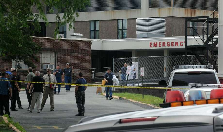 Troy Police detectives and officers gather near the Emergency Room entrance at the Samaritan Hospital in Troy Wednesday morning, after a Maryland man committed suicide on the stairs near that entrance. (Skip Dickstein / Times Union) Photo: SKIP DICKSTEIN