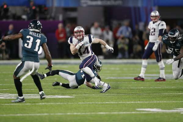 New England Patriots' Rex Burkhead runs against the Philadelphia Eagles during the second half of the NFL Super Bowl 52 football game Sunday, Feb. 4, 2018, in Minneapolis. (AP Photo/Jeff Roberson)