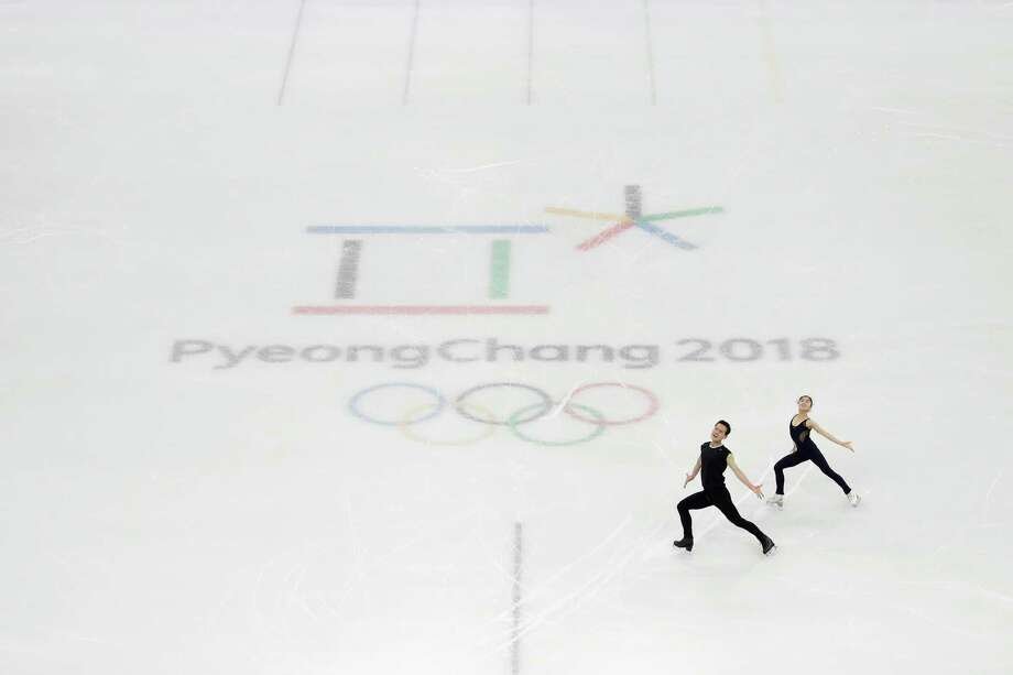 North Korea's Ryom Tae Ok and Kim Ju Sik get in some time on the ice Sunday during a training session at Gangneung, South Korea. The figure skaters are part of a contingent from North Korea that is participating in the Pyeongchang Winter Olympics, which officially begin Friday. Photo: Felipe Dana, STF / Copyright 2018 The Associated Press. All rights reserved