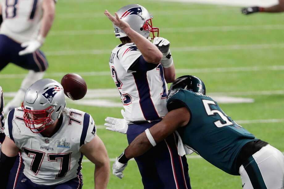 MINNEAPOLIS, MN - FEBRUARY 04:  Tom Brady #12 of the New England Patriots has the ball stripped by Brandon Graham #55 of the Philadelphia Eagles late in the fourth quarter in Super Bowl LII at U.S. Bank Stadium on February 4, 2018 in Minneapolis, Minnesota.  (Photo by Streeter Lecka/Getty Images) Photo: Streeter Lecka, Getty Images