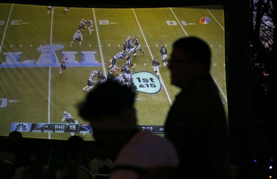 Football fans watch Super Bowl LII Sunday Feb. 4, 2018 at The Friendly Spot. Photo: Edward A. Ornelas, Staff / San Antonio Express-News / © 2018 San Antonio Express-News