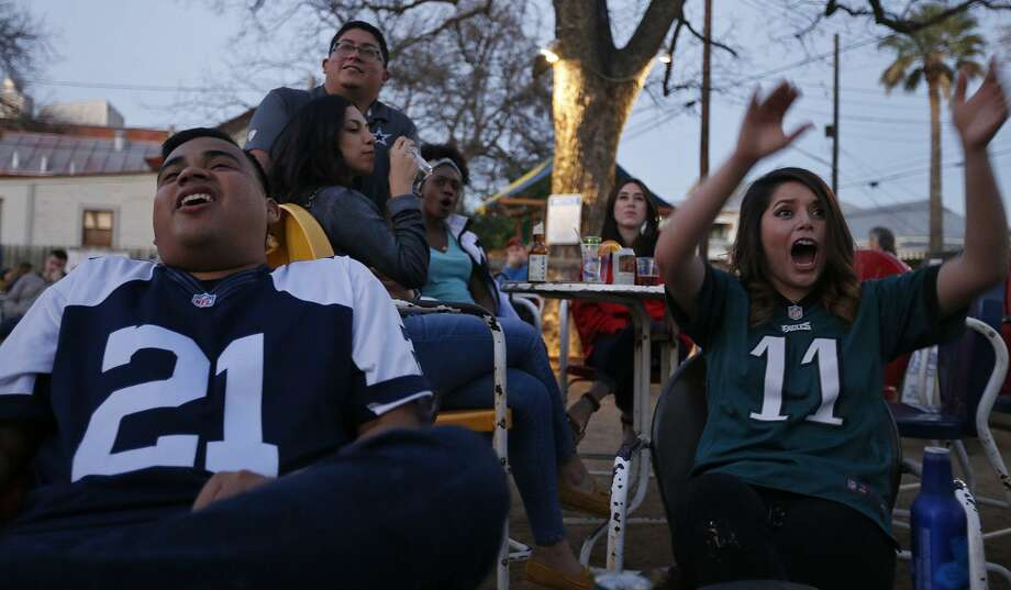 Football fans Angel Martinez (left) and Abigail Rodriguez react to an Eagles touchdown against the Patriots while watching Super Bowl LII Sunday Feb. 4, 2018 at The Friendly Spot. Photo: Edward A. Ornelas, Staff / San Antonio Express-News / © 2018 San Antonio Express-News