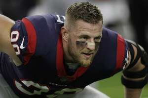 FILE - This Oct. 8, 2017 photo shows Houston Texans defensive end J.J. Watt (99) warming up before an NFL football game against the Kansas City Chiefs in Houston. Watt, along with Greg Olsen and Benjamin Watson, is a finalist for the NFL's Walter Payton Man of the Year award. (AP Photo/David J. Phillip, file)