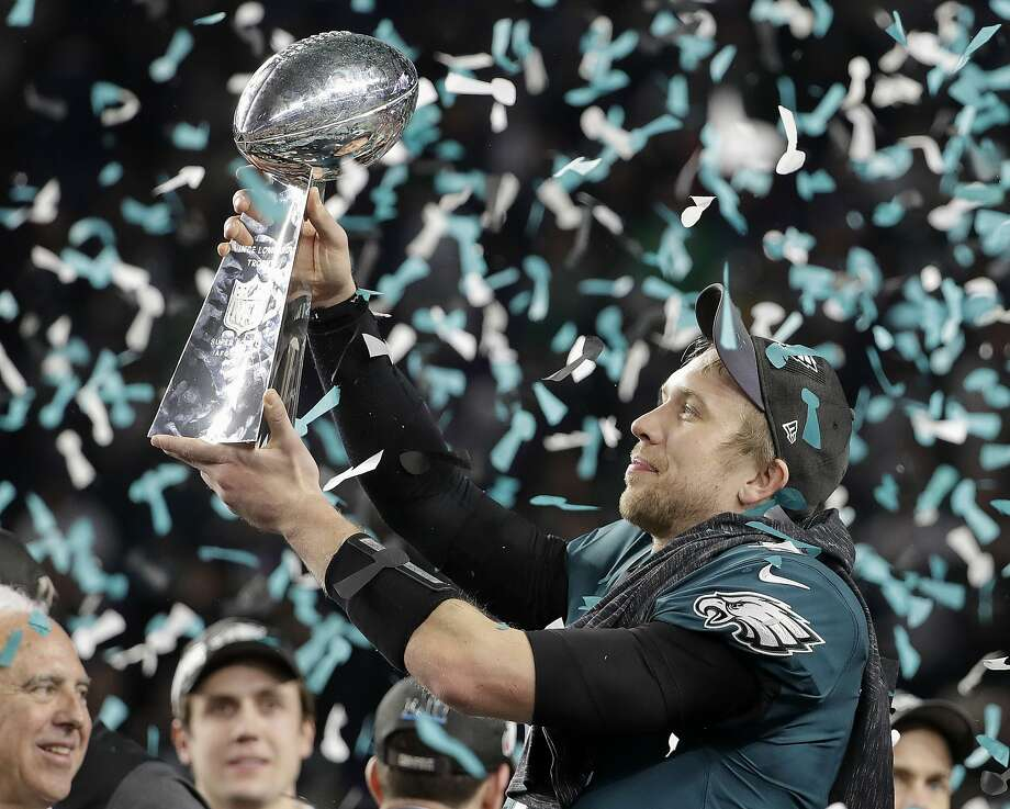Philadelphia Eagles' Nick Foles holds up the Vince Lombardi Trophy after the NFL Super Bowl 52 football game against the New England Patriots, Sunday, Feb. 4, 2018, in Minneapolis. The Eagles won 41-33. (AP Photo/Chris O'Meara) Photo: Chris O'Meara, Associated Press