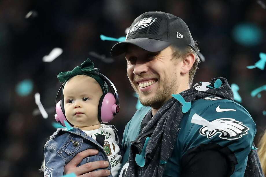 Eagles quarterback Nick Foles, shown with his daughter, Lily, earned the MVP award after throwing for 373 yards in a victory. Photo: Rob Carr, Getty Images