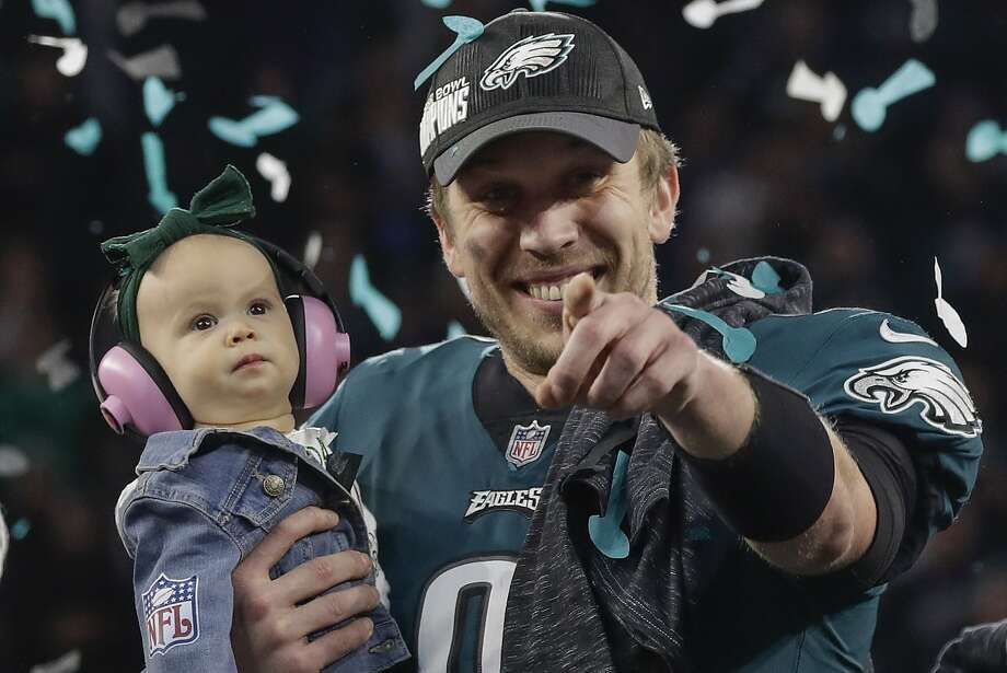 Philadelphia Eagles  Nick Foles holds his daughter Lily after the NFL Super  Bowl 52 football e03b4768f