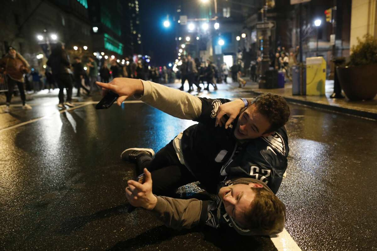 Fans celebrate in Center City after the Philadelphia Eagles defeated the New England Patriots to win the Super Bowl on February 4, 2018 in Philadelphia, Pennsylvania. (Photo by Aaron P. Bernstein/Getty Images)