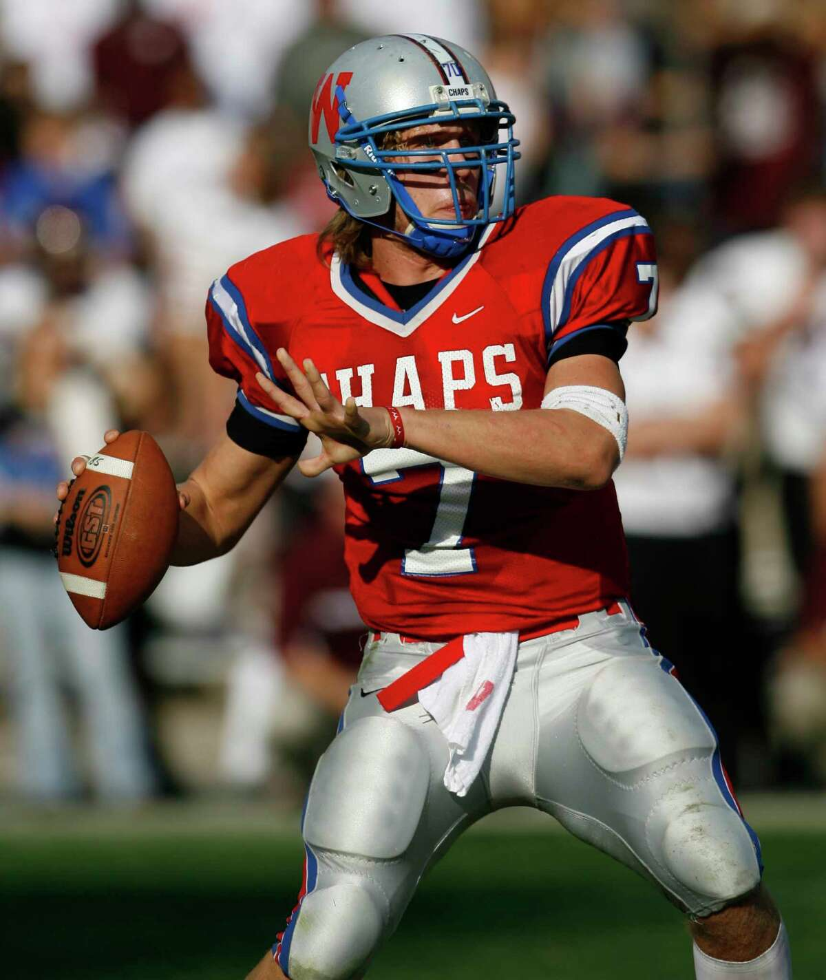 Westlake High School senior quarterback Nick Foles (7) looks to pass downfield in the first half of the Pearland High School vs. Westlake High School Class 5A Division I State Semifinals football game at Kyle Field on Saturday December 16, 2006 in College Station, Texas. Westlake High School won 35-32 to advance to the state championship game next weekend in San Antonio, Texas.