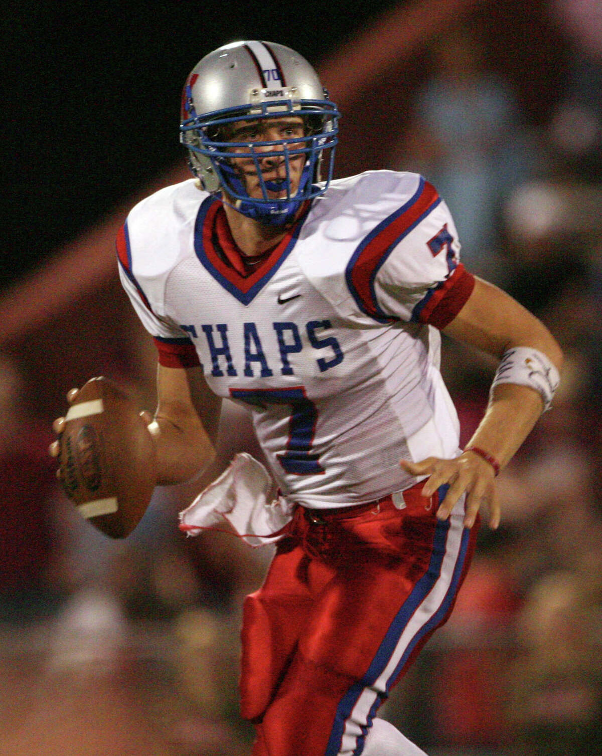 FILE - In this Sept. 29, 2006 file photo, Westlake High School quarterback Nick Foles looks for a receiver against Austin High during a football game in Austin, Texas. Ten years after Drew Brees led Westlake High School to victory in the Texas state championship game, Foles broke several of his passing records but lost in the title game. The two quarterbacks meet with far more at stake _ Saints vs. Eagles in an NFC wild-card game. (AP Photo/Austin American Statesman, Jay Janner, File)
