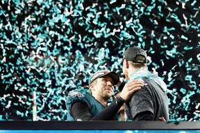 MINNEAPOLIS, MN - FEBRUARY 04: Nick Foles #9 of the Philadelphia Eagles celebrates with teammate injured quarterback Carson Wentz #11 after defeating the New England Patriots 41-33 in Super Bowl LII at U.S. Bank Stadium on February 4, 2018 in Minneapolis, Minnesota. (Photo by Elsa/Getty Images)