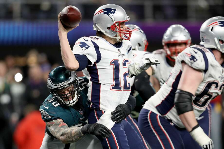 MINNEAPOLIS, MN - FEBRUARY 04:  Tom Brady #12 of the New England Patriots attempts to throw a pass under pressure from Derek Barnett #96 of the Philadelphia Eagles during the fourth quarter in Super Bowl LII at U.S. Bank Stadium on February 4, 2018 in Minneapolis, Minnesota.  (Photo by Patrick Smith/Getty Images) Photo: Patrick Smith/Getty Images