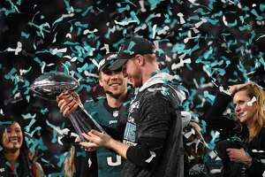 Quarterbacks Nick Foles (L) and Carson Wentz (R) of the Philadelphia Eagles celebrates following victory over the New England Patriots in  Super Bowl LII at US Bank Stadium in Minneapolis, Minnesota, on February 4, 2018. The Philadelphia Eagles scored a stunning 41-33 upset victory over the New England Patriots to win their first ever Super Bowl after a costly Tom Brady fumble ended the quarterback's tilt at history. Foles was a back-up who was thrust into the starting position when Carson Wentz suffered a season-ending injury in December.  / AFP PHOTO / TIMOTHY A. CLARYTIMOTHY A. CLARY/AFP/Getty Images