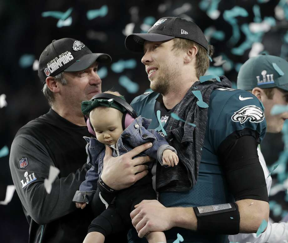 Philadelphia Eagles' Nick Foles, right, holds up his daughter Lily as and head coach Doug Pederson celebrate after the NFL Super Bowl 52 football game against the New England Patriots Sunday, Feb. 4, 2018, in Minneapolis. The Eagles won 41-33. (AP Photo/Chris O'Meara) Photo: Chris O'Meara/Associated Press