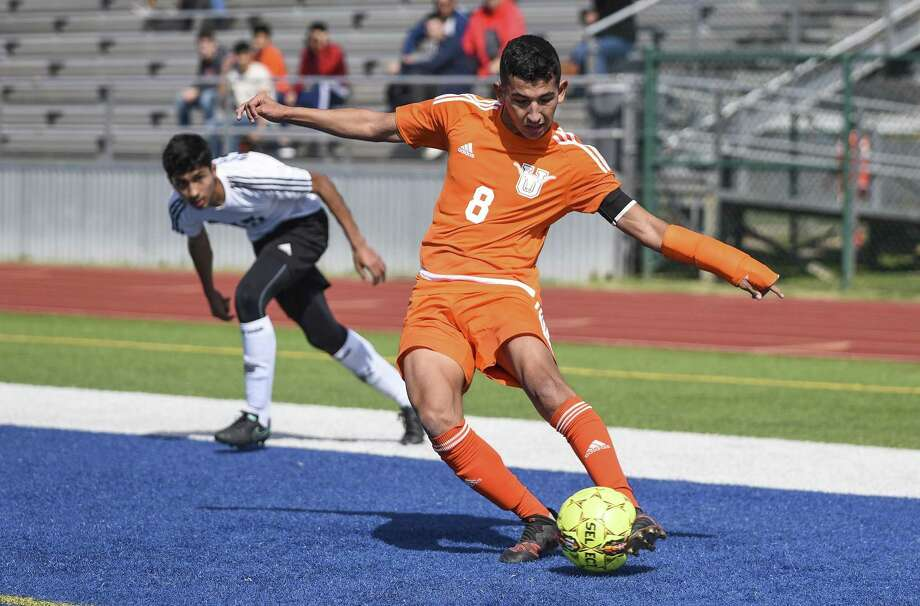 Martell Martinez scored the Longhorns' second goal in their 2-1 victory over McAllen Memorial in the bi-district round of the playoffs Wednesday night. Photo: Danny Zaragoza /Laredo Morning Times File