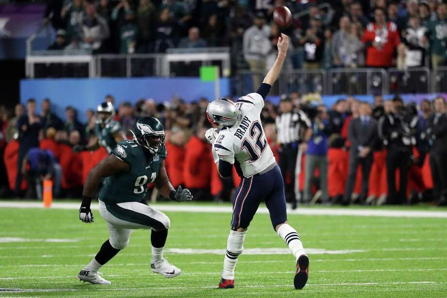 Patriots quarterback Tom Brady throws an incomplete pass on the final play of the game as his team loses 41-33 to the Eagles in Super Bowl LII on Sunday at U.S. Bank Stadium in Minneapolis. Photo: Rob Carr / Getty Images / 2018 Getty Images
