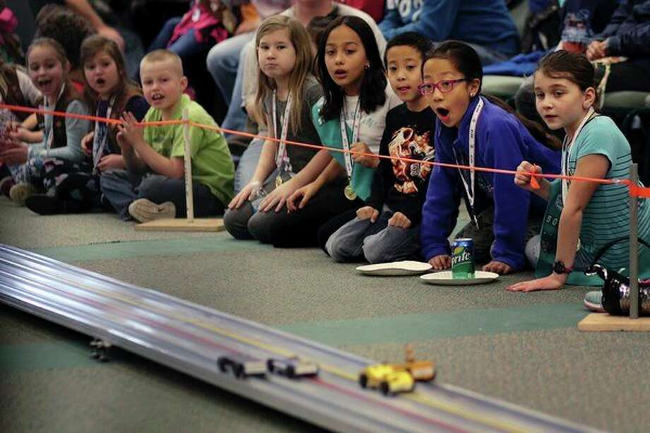 Neck and neck at the Pinewood Derby 				Girl Scouts race their cars Saturday during the Pinewood Derby at Trinity Lutheran Church in Midland. (Samantha Madar/for the Midland Daily News)