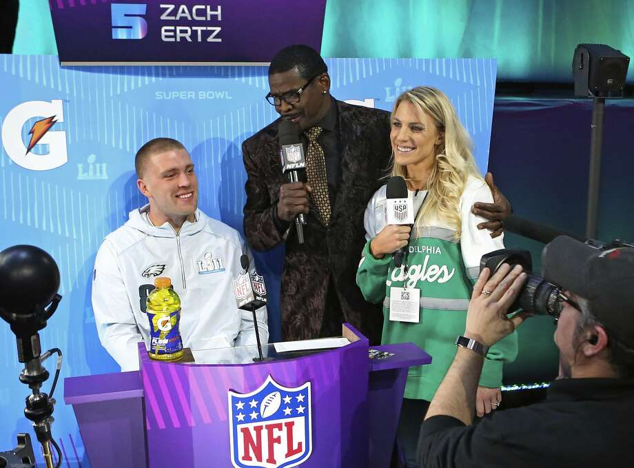 "In this Jan. 29, 2018, photo, Philadelphia Eagles tight end Zach Ertz, from left, is interviewed by Michael Irvin, and Zach's wife Julie Ertz during opening night for the NFL Super Bowl 52 football game at Xcel Energy Center in St. Paul, Minn. Julie and Zach are currently the sporting world's ""It"" couple. Julie is a midfielder for the World Cup-winning U.S. national soccer team, while her husband Zach is a tight end for the Super Bowl-bound Philadelphia Eagles. (AP Photo/Gregory Payan) Photo: Gregory Payan, Associated Press"
