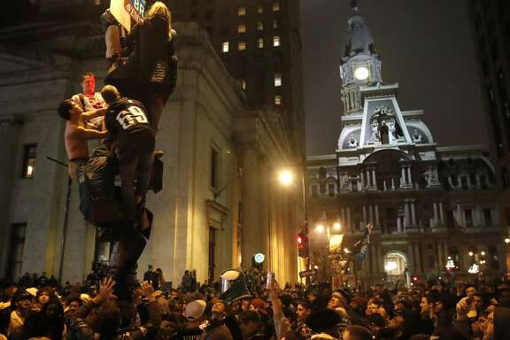 Philadelphia Eagles fans celebrate the team's victory in NFL Super Bowl 52 between the Philadelphia Eagles and the New England Patriots, Sunday, Feb. 4, 2018, in downtown Philadelphia. (AP Photo/Matt Rourke)