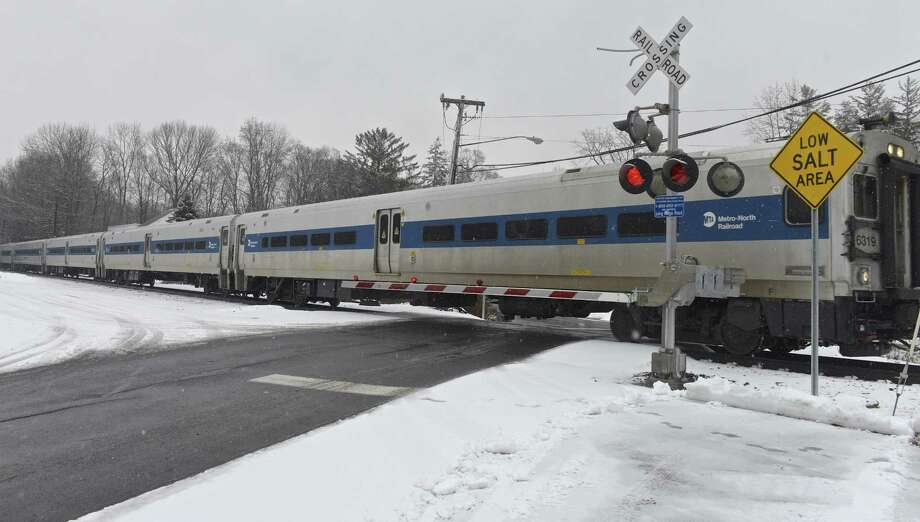 A south bound Metro North Danbury Line train enters the Long Ridge Road train crossing on Wednesday afternoon. The state is finishing up designs on a project that aims to improve the Long Ridge Road train crossing in Redding, Conn. Wednesday, January 17, 2018. Photo: H John Voorhees III / Hearst Connecticut Media / The News-Times