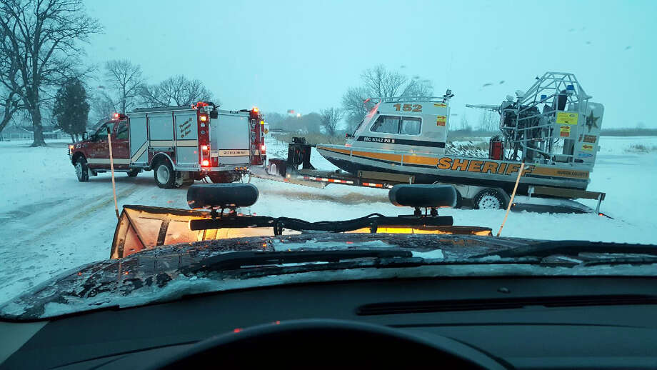In this courtesy photo, the Huron County Sheriff's Office airboat is being pulled off the ice after the bodies of two ice fisherman were recovered from Saginaw Bay. (Submitted Photo)