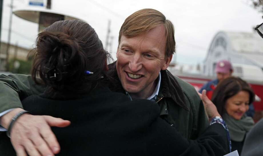 Andrew White, a Democrat who is seeking the nomination to run against Gov. Greg Abbott, greets Mary Lou Alvarez, candidate for 45th district court judge, during a Jan. 17 campaign stop in San Antonio. Photo: Ronald Cortes /For The San Antonio Express-News / 2017 Ronald Cortes