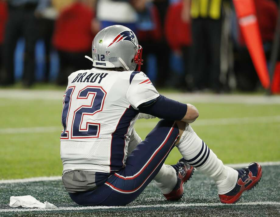 New England Patriots' Tom Brady sits on the field after the NFL Super Bowl 52 football game against the Philadelphia Eagles Sunday, Feb. 4, 2018, in Minneapolis. The Eagles won 41-33. (AP Photo/Charlie Neibergall) Photo: Charlie Neibergall, Associated Press