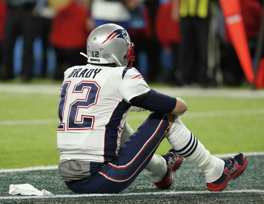 New England Patriots' Tom Brady sits on the field after the NFL Super Bowl 52 football game against the Philadelphia Eagles Sunday, Feb. 4, 2018, in Minneapolis. The Eagles won 41-33. (AP Photo/Charlie Neibergall) Photo: Charlie Neibergall, STF / Associated Press / Copyright 2018 The Associated Press. All rights reserved.