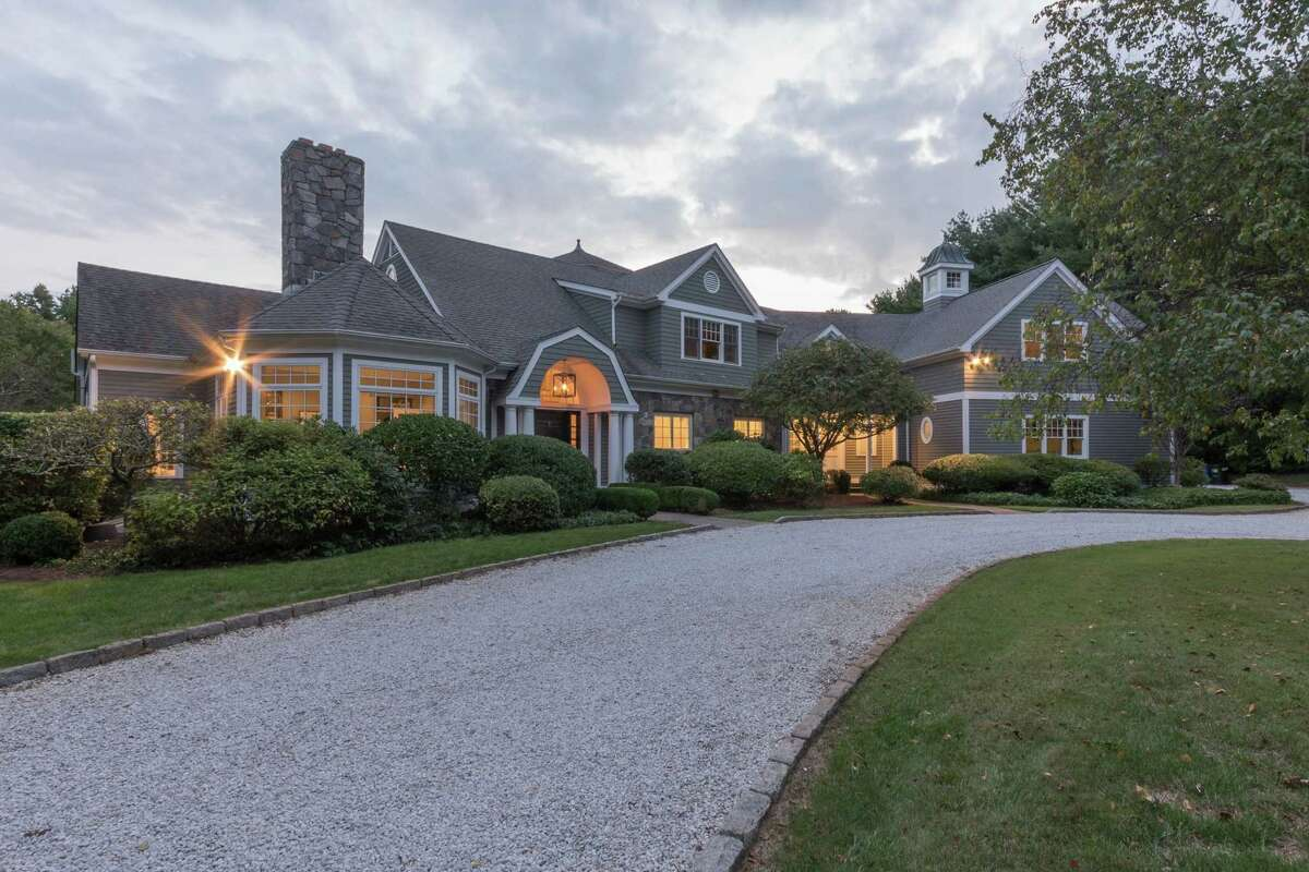 The custom-built shingle and stone colonial house at 5 Pony Road in the Coleytown neighborhood features a tennis court and heated Gunite in-ground swimming pool.