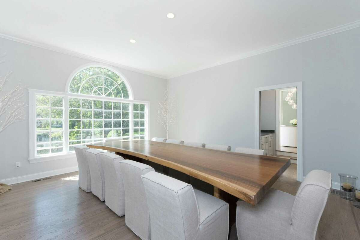 The oversized formal dining room can comfortably seat 12.