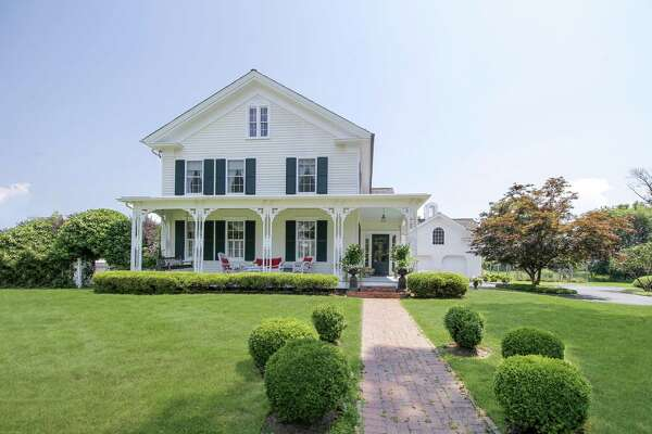 The antique Victorian house at 840 Mill Hill Road sits on a one-acre level and gated property in Southport.