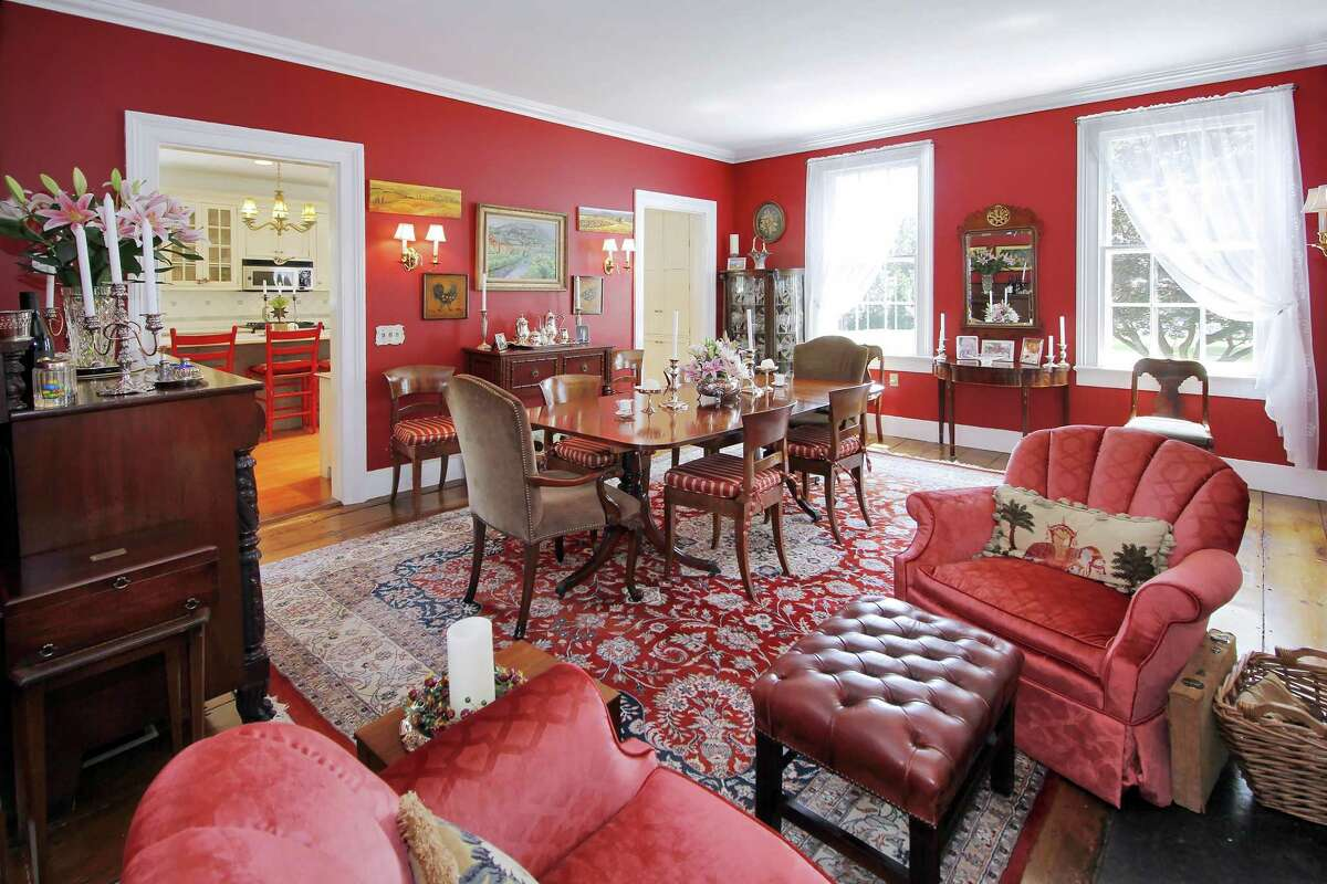In the oversized formal dining room there is a tall fireplace and built-in bookshelf.