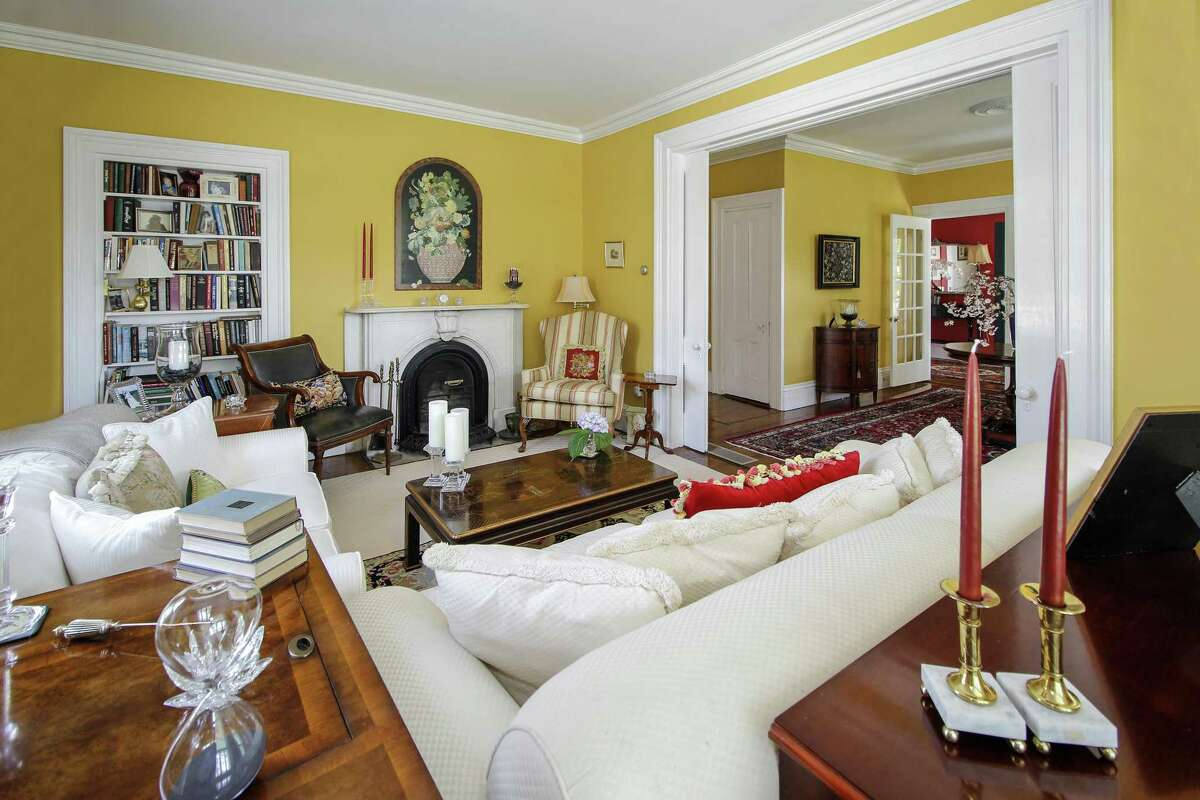 The formal living room features a fireplace with a decorative alabaster mantel with a keystone.