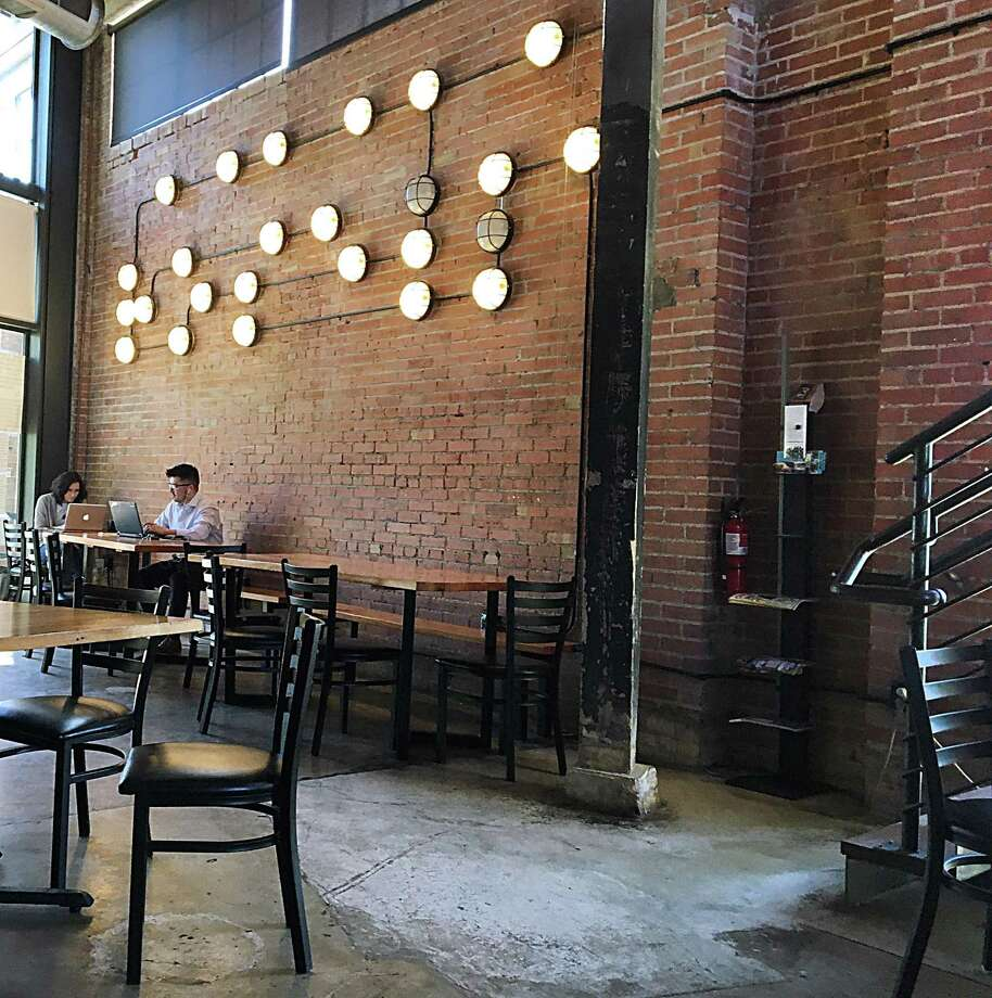 The downstairs coffee lounge at Rosella Coffee Co. on East Jones Avenue. Photo: Mike Sutter /San Antonio Express-News