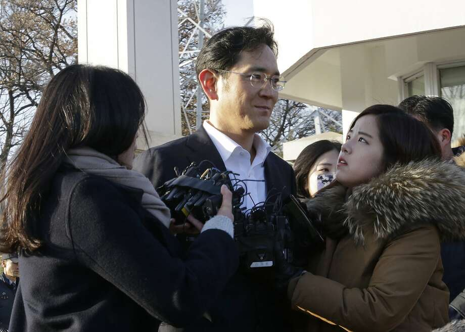 Lee Jae-yong, vice chairman of Samsung Electronics, talks to reporters after leaving a detention center. The Seoul High Court rejected most of the bribery charges leveled against him. Photo: Ahn Young-joon, Associated Press