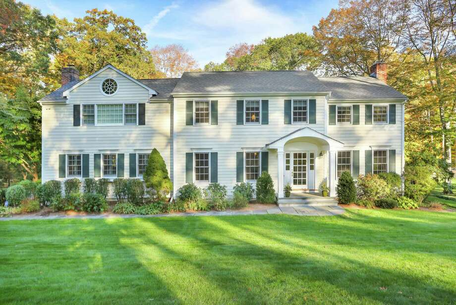 The 4,348-square-foot colonial house at 559 Cheese Spring Road sits on a two-acre level property.