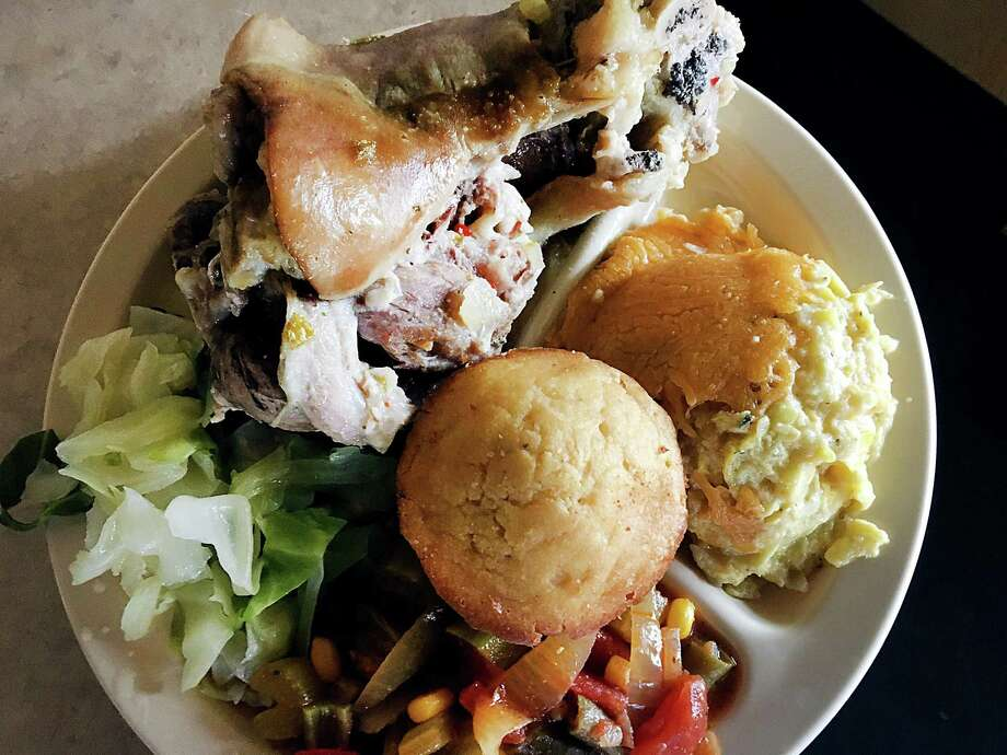 A meat and three-vegetable plate with a hamhock and a cornbread muffin from Mr. & Mrs. G's Home Cooking. Photo: Mike Sutter /San Antonio Express-News