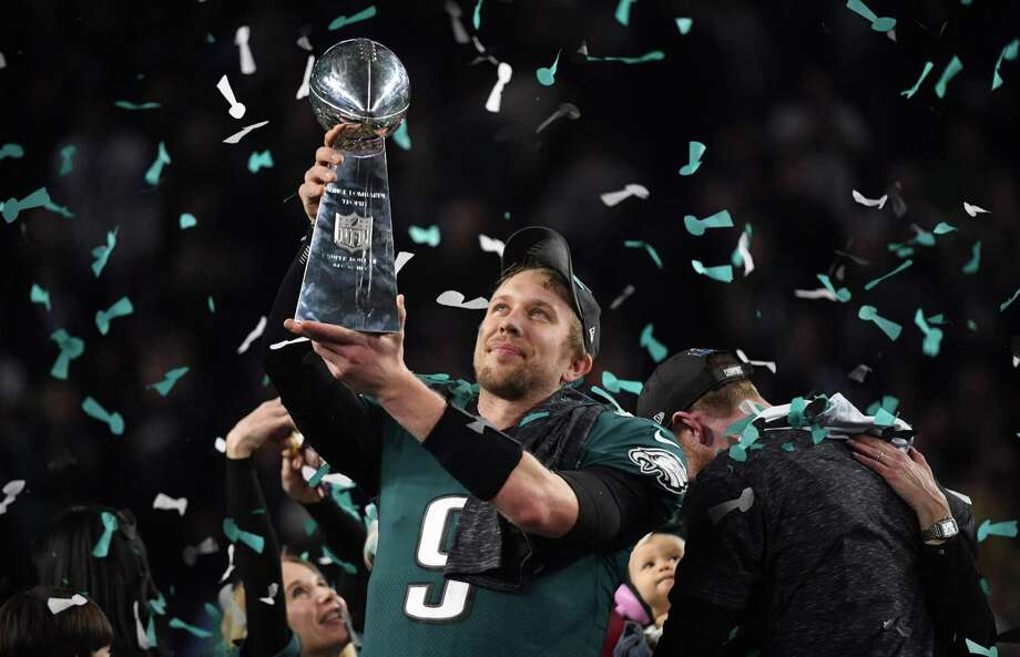 TOPSHOT - Philadelphia Eagles quarterback Nick Foles celebrates after winning Super Bowl LII against the New England Patriots at US Bank Stadium in Minneapolis, Minnesota, on February 4, 2018. The Eagles won 41-33 / AFP PHOTO / TIMOTHY A. CLARYTIMOTHY A. CLARY/AFP/Getty Images Photo: TIMOTHY A. CLARY, Contributor / AFP or licensors