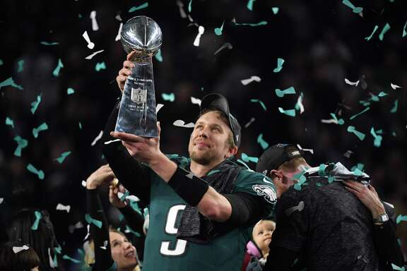 TOPSHOT - Philadelphia Eagles quarterback Nick Foles celebrates after winning Super Bowl LII against the New England Patriots at US Bank Stadium in Minneapolis, Minnesota, on February 4, 2018. The Eagles won 41-33 / AFP PHOTO / TIMOTHY A. CLARYTIMOTHY A. CLARY/AFP/Getty Images