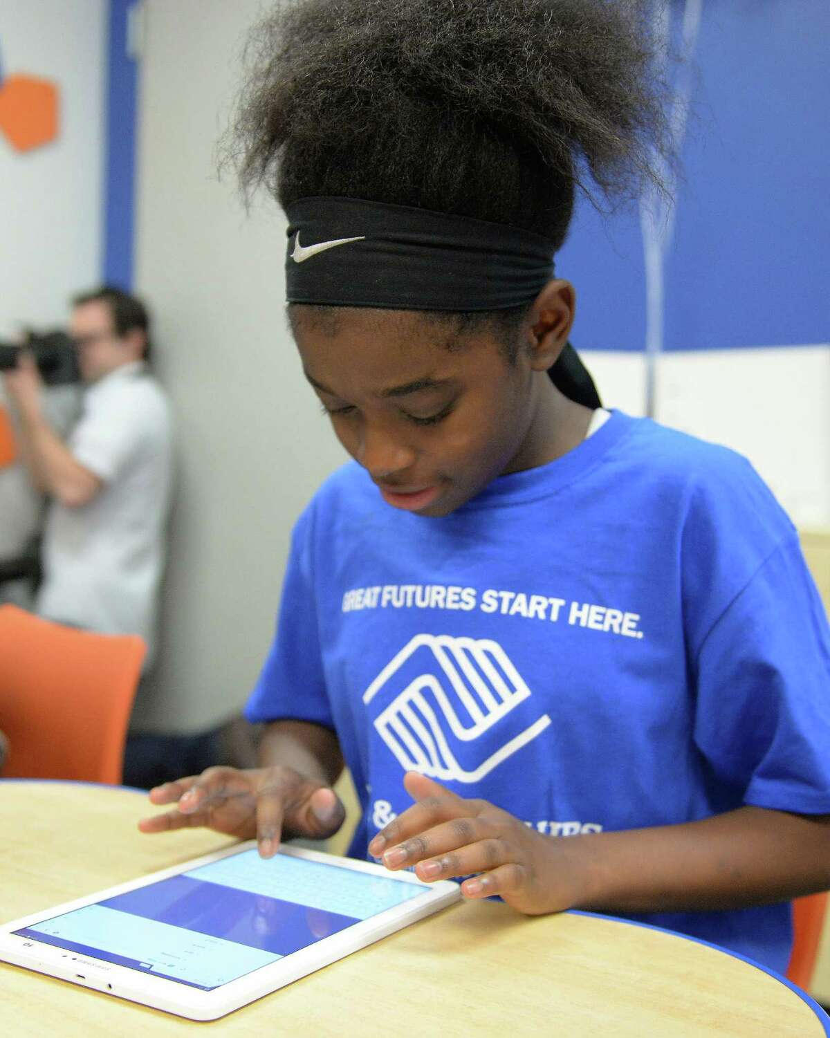 A Club member uses a tablet during the unveiling of an updated Tech Center at the Boys and Girls Club in Stafford, TX on Friday, February 2, 2018.