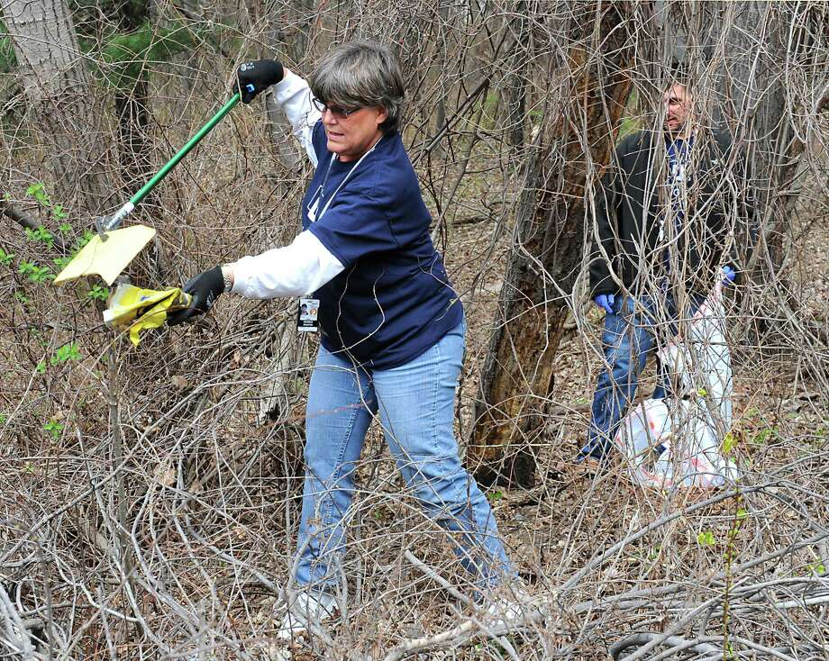 In this file photo, volunteers pick up trash on Earth Day. The Woodlands is seeking volunteers for its Earth Day GreenUp day set for March 24.  (Lori Van Buren / Times Union) Photo: Lori Van Buren, STAFF PHOTOGRAPHER / 10036217A